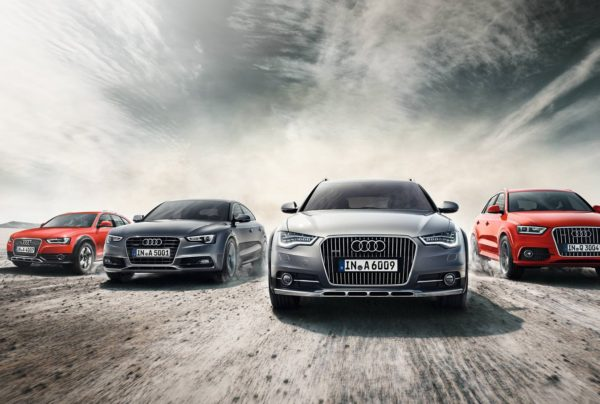 Four Audi vehicles in rough terrain