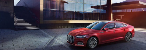 2019 Audi A5 in red parked outside of a modern building